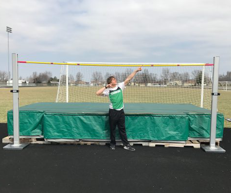 "Track star! Cameron Getz poses in front of the high jump mat. Getz is really pumped he ended up accomplishing a new personal best at the most recent meet. Getz stated, ""It was a class 1A,  2A, and 3A meet, and I was ranked third coming out. I didn"