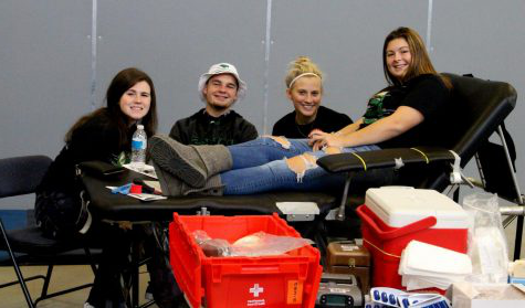 Jesse Damery, Drew Snow, and Erica Corzine sit with Peyton Latham as she prepares to give blood. Meridian held a blood drive on November 2 during a time which allowed students to donate during their classes.