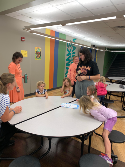 Courtney Sollman teaching Pre-K kids how to play her board game.
