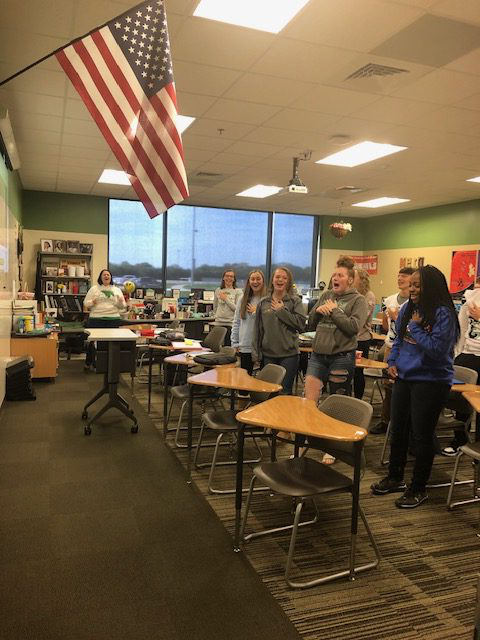 Students+in+Sheila+Moore%27s+fifth+hour+Honors+English+2+class+stand+and+sing+the+Fergie+version+of+the+National+Anthem+during+fifth+hour.+%22I+think+it%27s+a+great+way+for+this+group+to+be+themselves%2C%22+said+Moore.