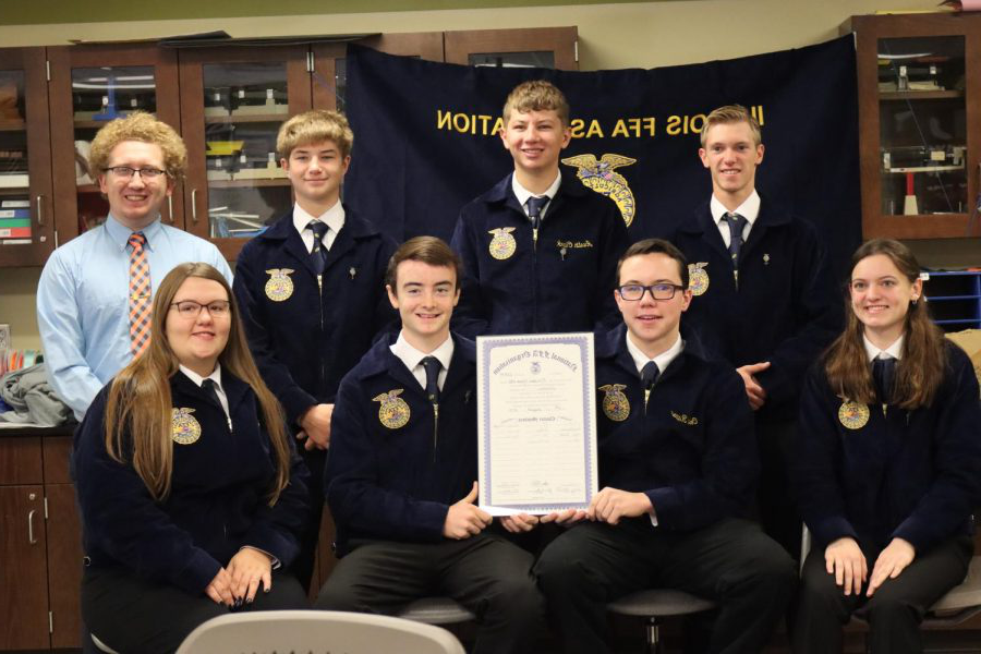 Meridian+FFA+chapter+poses+with+their+charter.+%22It+makes+us+more+official%2C%22+said+Brockett.