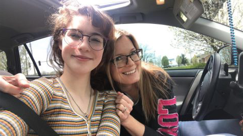 Emery Johnson and her mom stop for a selfie in their car. They like to drive around and look at houses for sale.