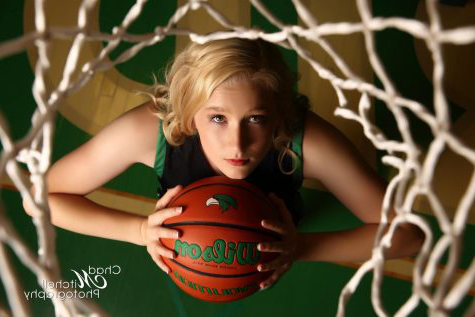 "One of the senior photos for Breanna Evans during her senior photo shoot with Chad Mitchell Photography. Evans started playing 篮球 in sixth grade. ""I first met and began working with Bre when she was in 6th grade. She had a lot of raw talent, and worked hard at improving her game. She was always a good kid, very respectful, and willing to listen and learn,"" Breanna"
