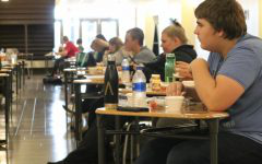 Meridian students sit social distanced at lunch everyday in the Great Hall with masks 上 until they get their food. This was a change for students who were accustomed to freedom to sit where they want, stand in line for food, and have a variety of food choices.